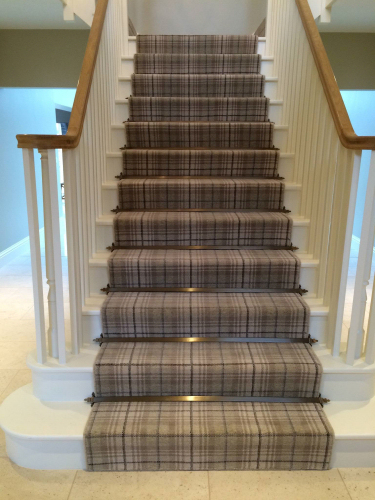 Ulster Beaumont Axminster carpet finished with Beaumont antique brass stair rods